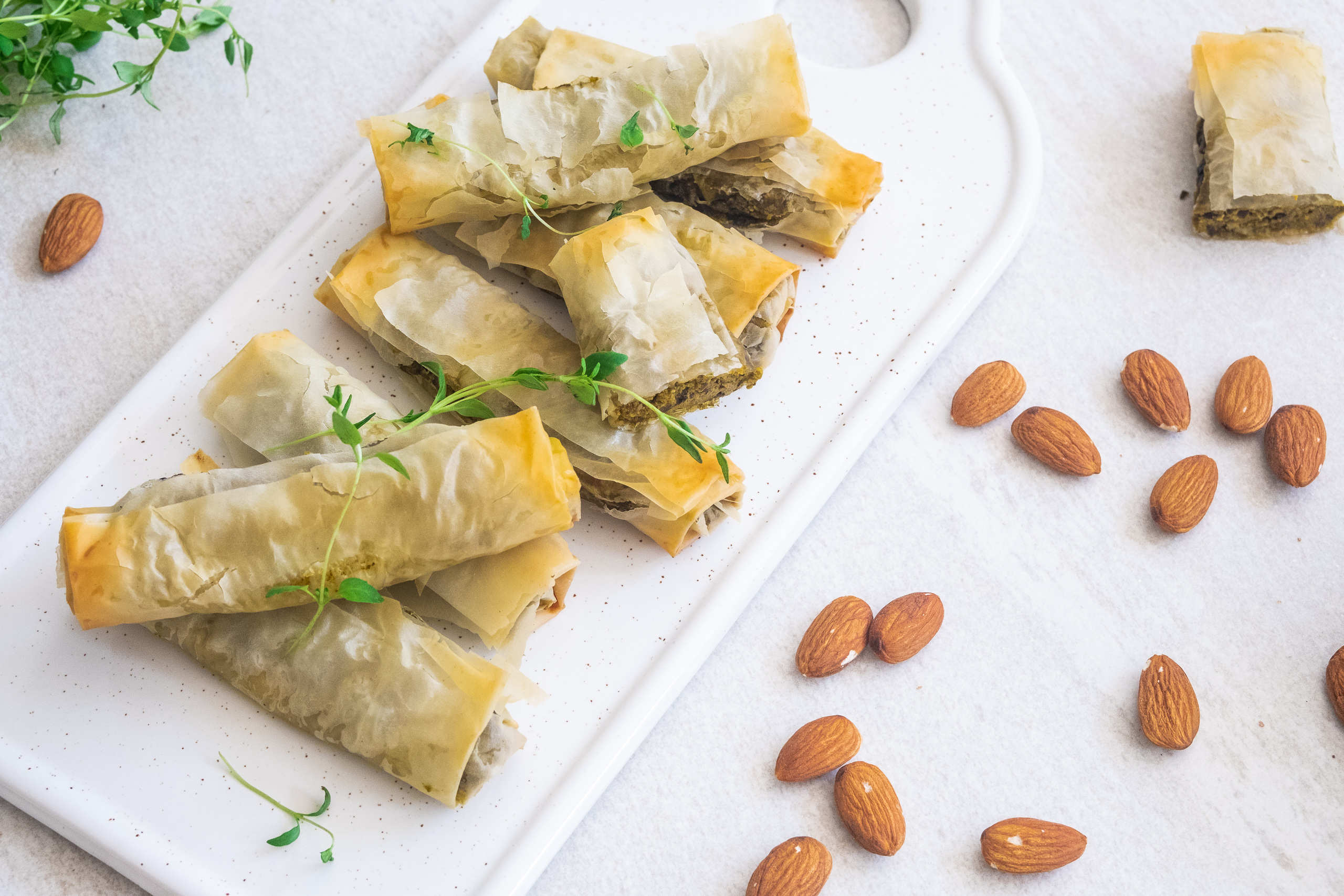 Vegan phyllo rolls with creamy sweet potato ans spinach filling